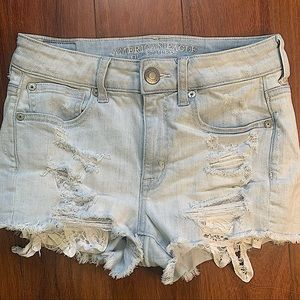 AMERICAN EAGLE HIGH RISE BLUE RIPPED JEAN SHORTS
